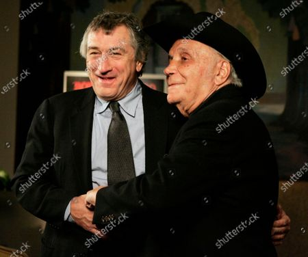 """Robert De Niro, left, and boxer Jake LaMotta stand for photographers before watching a 25th anniversary screening of the movie """"Raging Bull,"""" in New York. The Associated Press has compiled a list of the best sports movies ever made - a one-of-a-kind AP Top 25. Seventy writers and editors who work for the company around the world participated in the vote"""