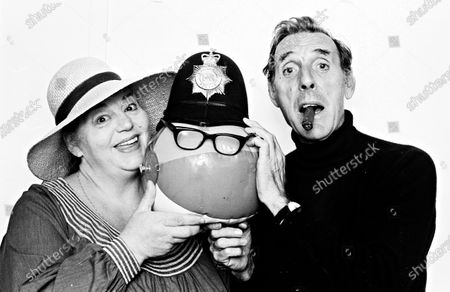 Hattie Jacques and Eric Skyes put a Policeman's helmet on a beach ball back stage at the Bournmouth Playhouse where their summer show a Hatful of Sykes was performing.