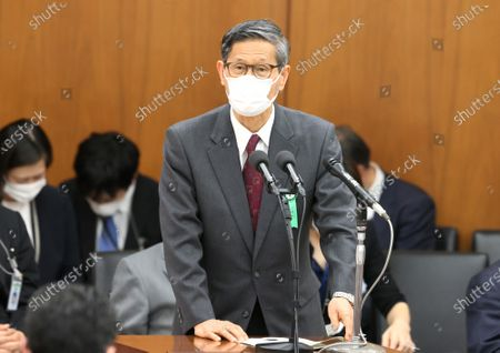 Stock Image of Shigeru OMI, president of Japan Committee Health Care Organization and the government's new coronavirus expert meeting member wearing a face mask answers a question at Lower House's health, labour and welfare committee session at the National Diet in Tokyo. Shinzo Abe expanded a state of emergency across Japan to prevent outbreak of the new coronavirus on April 17.