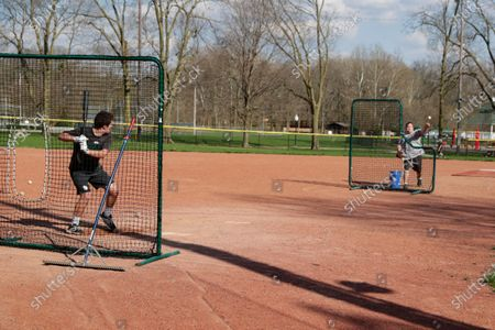 Stock Photo of Wes Anderson throws to his son Case at Lions Park in Zionsville, Ind., as they practice in case baseball resumes after the season was stopped due to the coronavirus outbreak. Officials and experts are estimating tens of millions of dollars in losses for youth sports facilities because of the shutdown