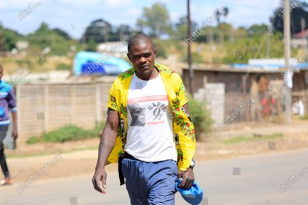 A man wearing a shirt with a picture of the late former Zimbabwean President Robert Mugabe in the township of Tafara, Harare, Zimbabwe, 18 April 2020. Zimbabweans could not publicly celebrate attaining 40 years of independence due to the covid19 pandemic caused by the coronavirus.