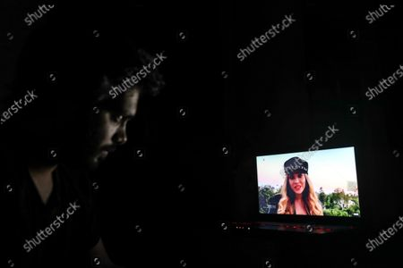 A man watches US singer Beyonce Knowles performing during the 'One World: Together At Home' broadcast at his home in Paris, France, 18 April 2020. The eight-hour event run by the Global Citizen movement in cooperation with US artist Lady Gaga and the World Health Organization (WHO) is being live-streamed and broadcast on TV to support the health workers around the world fight with the SARS-CoV-2 coronavirus pandemic which causes the Covid-19 disease.