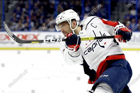 Stock Picture of Washington Capitals left wing Alex Ovechkin follows through on a shot against the Tampa Bay Lightning during the first period of an NHL hockey game in Tampa, Fla. Possibly losing as many as 13 games with the NHL on hold because of the coronavirus pandemic could leave Ovechkin two short of another 50-goal season and threaten his ability to break Wayne Gretzky's all-time record