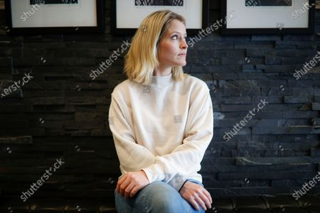 """Television host and journalist Sara Haines is photographed in her lobby after working from home due to COVID-19 concerns, in the Brooklyn borough of New York. Haines isn't afraid to tackle serious subjects and has done so often as a co-host on """"The View."""" Monday felt different. Confined to her home, she broadcast a segment from her living room couch about grief, compassion and loneliness"""