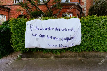 """If we winter this one out we can summer anywhere"" - Seamus Heaney, 1972. Banner on a garden hedge quoting an Irish poet in Rathmines during lockdown due to COVID-19."