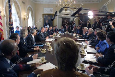 United States President George W. Bush holds a Cabinet meeting at the White House in Washington, DC. During the meeting he made another statement on the China situation. Pictured from lower left around the table going to the right: US Secretary of Education Rod Paige; US Secretary of Health and Human Services Tommy Thompson; US Secretary of Interior Gale Norton; US Secretary of State Colin Powell; President Bush; US Secretary of Defense Donald Rumsfeld; US Secretary of Commerce Don Evans; US Secretary of Transportation Norman Mineta; OMB Director Mitch Daniels; White House Chief of Staff Andy Card; US Trade Representative Robert Zoellick; US Secretary of Housing and Urban Development Mel Martinez; US Secretary of Agriculture Ann Veneman; US Secretary of Treasury Paul O'Neill; US Vice President Dick Cheney; US Attorney General John Ashcroft; US Secretary of Labor Elaine Chao; US Secretary of Energy Spencer Abraham; and Administrator of Environmental Protection Agency Christine Todd Whitman. White House Press Secretary Ari Fleischer is also visible in the upper center background in front of the Eisenhower portrait.