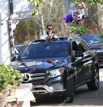 Cars as Kate Hudson celebrates her birthday by drive thru during quarantine