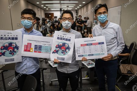 Stock Image of Hong Kong pro-democracy activists Joshua Wong (L) and Nathan Law (C), and lawmaker Eddy Chu Hoi-dick (R), present a new report on Beijing's liaison office's property portfolio in Hong Kong, China, 20 April 2020. The report claims that Beijing dramatically expanded its properties in the city since the 2014 Occupy protests and currently owns 757 properties in Hong Kong, worth some HK$3.4 billion (438 million US dollar).