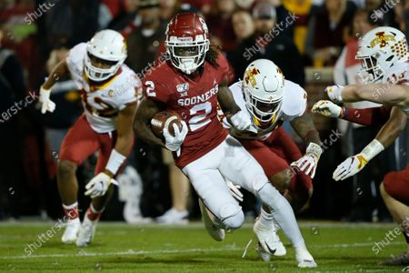Oklahoma wide receiver CeeDee Lamb (2) carries past Iowa State linebacker Marcel Spears Jr., linebacker O'Rien Vance and defensive back Lawrence White, from left, during the first quarter of an NCAA college football game in Norman, Okla. Lame was an All-American and Biletnikoff Award finalist last season