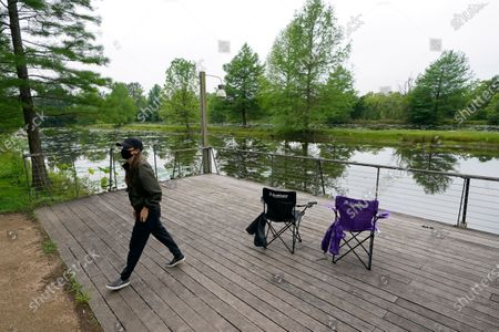 Susan Shin walks back to get her fishing pole, at Sheldon Lake State Park and Environmental Learning Center in Houston. Texas Gov. Greg Abbott has ordered state parks to reopen Monday after being closed due to the COVID-19 outbreak