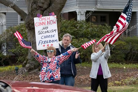 "Stock Picture of Sophia Brown, left, and her husband Bill Brown are joined by a woman who did not give her name as they participate in a rally in front of the governor's mansion during the coronavirus pandemic, in Hartford, Conn. The rally, organized by CT Liberty Rally, is asking Gov. Ned Lamont to allow people to make their own decisions when it comes to their health. ""Let the world know the citizens of Connecticut are standing up for their rights that their economy be re-opened,"" said Jonathan Johnson, of CT Liberty Rally"