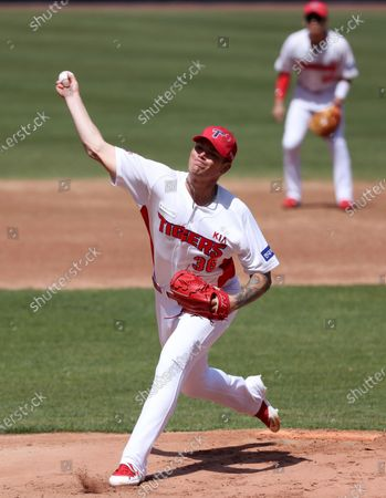 Kia Tigers pitcher Aaron Brooks throws during an exhibition game against the Samsung Lions in the southwestern city of Gwangju, South Korea, 21 April 2020, with the game played without spectators amid the coronavirus pandemic. The Korea Baseball Organization said the same day that the 2020 regular season, postponed from its March 28 start date due to the coronavirus outbreak, will begin May 5.