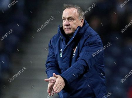 Feyenoord's head coach Dick Advocaat gestures during their Europa League group G soccer match against FC Porto at the Dragao stadium in Porto, Portugal. Veteran coach Dick Advocaat has extended his contract with Feyenoord by a year to keep him in charge of the Rotterdam club through next season, it was announced Tuesday, April 21, 2020. Feyenoord hired Advocaat in late October to succeed Jaap Stam, who resigned after less than half a season in charge and with the team struggling at 12th in the top flight Eredivisie