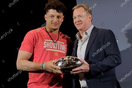 Kansas City Chiefs quarterback Patrick Mahomes, left, holds the MVP trophy with NFL Commissioner Roger Goodell before speaking at a news conference in Miami. After leading the Chiefs to their first Super Bowl championship in five decades, Mahomes is finally eligible to sign a contract extension this off-season