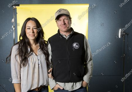 "Joanna Gaines, left, and Chip Gaines pose for a portrait in New York to promote their home improvement show, ""Fixer Upper,"" on HGTV. The Gaines' Magnolia Network will be blooming late because of the coronavirus crisis. The network's planned October launch is being pushed back because of production delays related to COVID-19 disease, it was announced Tuesday. Discovery Inc.'s DIY Network will be rebranded as the Magnolia Network when the joint venture with the Gaines launches. A new date wasn't immediately announced"