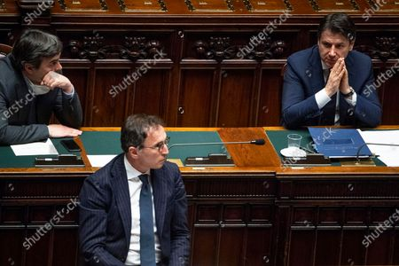Italian Prime Minister Giuseppe Conte (R) speaks with ministers Francesco Boccia (C) and Vincenzo Amendola (L) after he communicated the recent government initiatives to the deputies to cope with the COVID-19 pandemic in the Montecitorio hall in Rome, Italy, 21 April 2020.