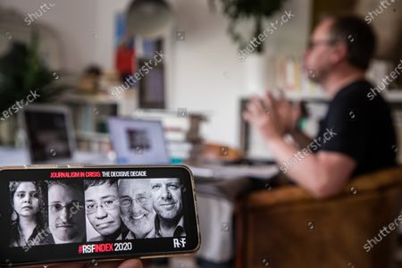 Christophe Deloire (R), Secretary General of Reporter Without Borders (RSF) attends a video conference call with US Whistleblower Edward Snowden (2-L on the screen) and US  Nobel Prize Joseph Stiglitz (2-R), during the launch of the 2020 Press Freedom Index, in Paris, France, 21 April 2020.