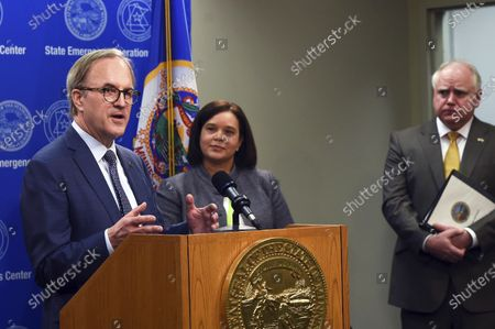 From left: Ecolab CEO Doug Baker, Minnesota Department of Administration Commissioner Alice Roberts-Davis and Minnesota Governor Tim Walz discuss the role of public-private partnerships in Minnesota's fight against COVID-19, during a news conference on in St. Paul, Minn