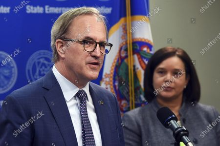 Stock Image of From left: Ecolab CEO Doug Baker and Minnesota Department of Administration Commissioner Alice Roberts-Davis discuss the role of public-private partnerships in Minnesota's fight against COVID-19, during a news conference with Governor Tim Walz on in St. Paul, Minn