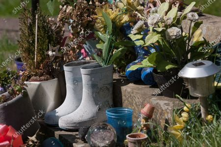 Wellington boots on the grave of Last of the Summer Wine actor Bill Owen, who played 'Compo'.