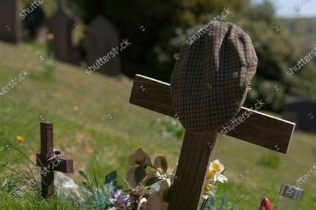 A flat cap adorns the grave of Peter Sallis O.B.E. who was known for playing 'Clegg' in Last of the Summer Wine. He is buried next to his friend Bill Owen in St. John's Church near Holmfirth.