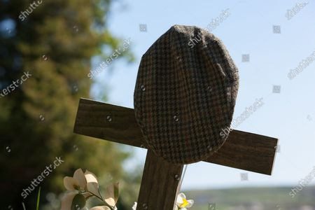 Stock Photo of A flat cap adorns the grave of Peter Sallis O.B.E. who was known for playing 'Clegg' in Last of the Summer Wine. He is buried next to his friend Bill Owen in St. John's Church near Holmfirth.
