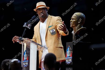 Former NFL safety Brian Dawkins delivers his induction speech at the Pro Football Hall of Fame in Canton, Ohio. Dawkins was the heart and soul on defense during the team's impressive run of success in the 2000s