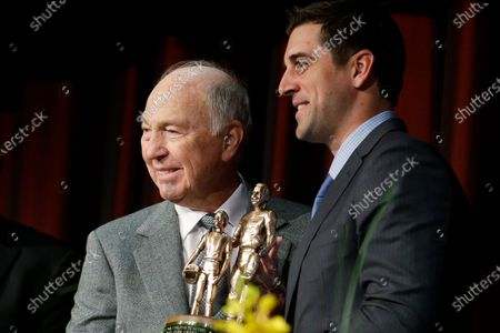Legendary Green Bay Packers quarterback Bart Starr, left, presents current Packers quarterback Aaron Rogers, right, with the the Bart Starr Award for Character and Leadership at the Super Bowl Breakfast in New York. When Roger's stock took a draft-day plunge in 2005, the Packers scooped him up with the 24th overall selection. Starr, the 1956 17th-round draft pick from Alabama led the Packers to five NFL championships and was the MVP of the first two Super Bowls during a Hall of Fame career