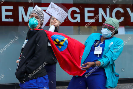 Health care workers seen outside Mount Sinal Hospital in Manhattan.
