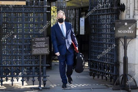 Nigel Adams MP, Minister of State, wears a protective face mask as he leaves The House of Commons. Parliament has re-opened today after the Easter holidays and the start of lockdown. The Speaker has asked MPs not to attend but to join in via Zoom where questions can be seen and heard on screens mounted in the chamber.