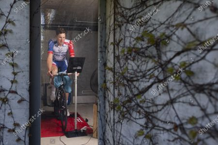 "Swiss professional cyclist Stefan Kueng is training on a home trainer for the Digital Swiss 5 race, on Wednesday, April 22, 2020, in Frauenfeld, Switzerland. Kueng starts at ""The Digital Swiss 5"", a digital race with professional teams, organized by the Tour de Suisse. The race starts today."