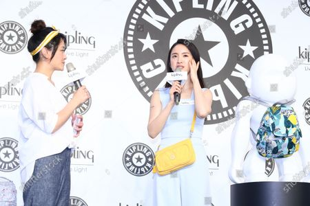 Ariel Lin promotes for Kipling Taiwan by wearing a blue jump-suit and yellow MYRTE bag