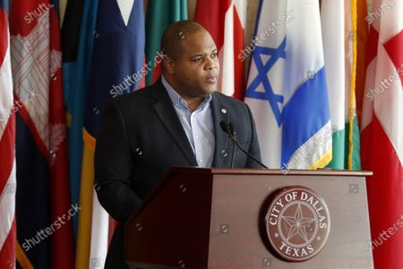 Mayor Eric Johnson reads from a statement during a news conference at City Hall to discuss the latest developments amid the coronavirus crisis in Dallas