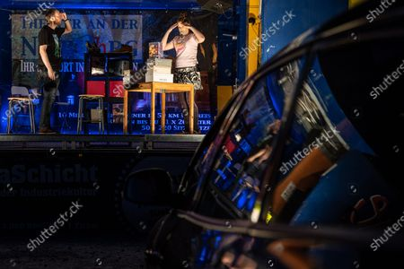 """Stock Image of Unusual theater experience in times of the corona crisis. Drive-in demonstration at the Theater an der Niebuhrg in Oberhausen. Guest performance from the Kleinen Theater Essen with the play """"Zwei wie Bonnie and Clyde"""" played by Nadine Mannel and Benjamin Haase. Since regular theater performances are currently banned in Germany due to the measures to contain the corona virus, there are now performances in the drive-in style in Oberhausen"""