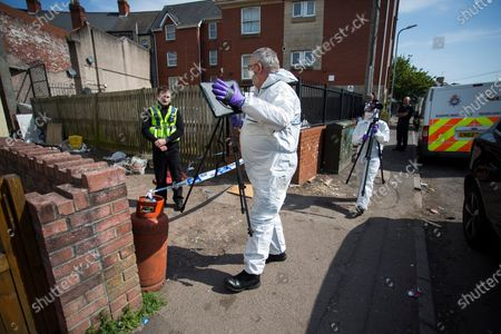 Forensics at the scene and a large police presence on St Vincent Road, Newport. Officers have been at the cordoned off side alley from the early hours of the morning.