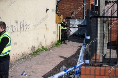 The large police presence on St Vincent Road, Newport. Officers have been at the cordoned off side alley from the early hours of the morning.