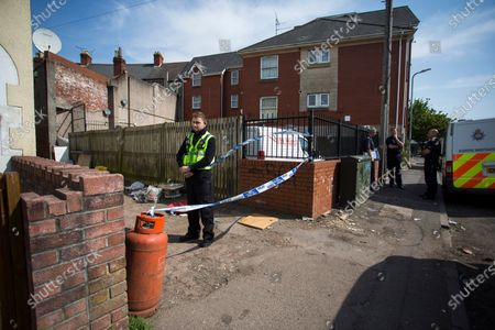Stock Image of The large police presence on St Vincent Road, Newport. Officers have been at the cordoned off side alley from the early hours of the morning.