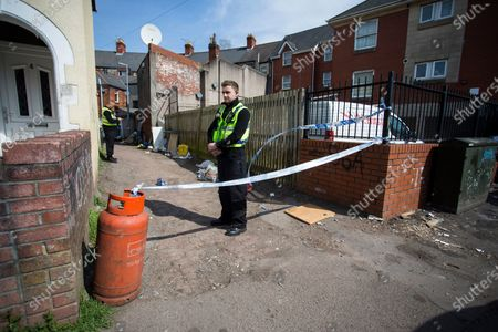 Stock Photo of The large police presence on St Vincent Road, Newport. Officers have been at the cordoned off side alley from the early hours of the morning.