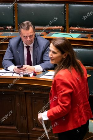 Stock Photo of Minister of Social Fraud, Privacy, the North Sea, Telecommunication and Administrative Simplification Philippe De Backer and Belgian Prime Minister Sophie Wilmes pictured during a plenary session of the chamber at the federal parliament, in Brussels, Thursday 23 April 2020.