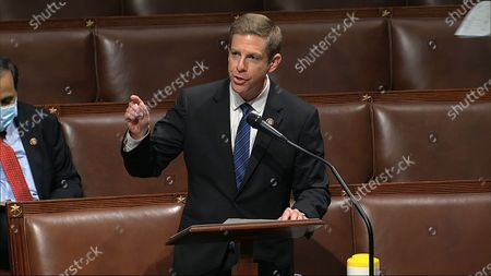 In this image from video, Rep. Mike Levin, D-Calif., speaks on the floor of the House of Representatives at the U.S. Capitol in Washington