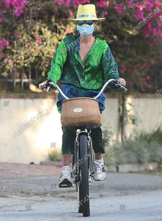 Laeticia Hallyday riding her bike in the Pacific Palisades