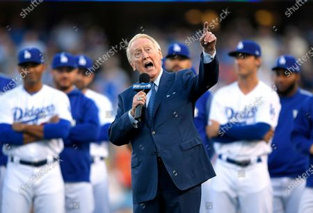 "Los Angeles Dodgers broadcaster Vin Scully speaks during his induction into the team's Ring of Honor prior to a baseball game between the Dodgers and the San Francisco Giants in Los Angeles. Scully took a fall in his home, and was taken to the hospital, where he was ""resting comfortably,"" the Dodgers announced Thursday, April 23. ""I won't be doing anymore headfirst sliding, I never liked it,"" the Hall of Fame broadcaster said in the team's statement posted on Twitter. Scully, 92, called Dodgers games for 67 seasons, spanning 13 National League pennants, six World Series championships, and a move across the country"