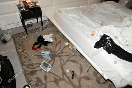 Made available Wednesday, April 23, by the Miami Beach Police Department shows the hotel room where former Florida Gubernatorial candidate Andrew Gillum was found drunk and with two other men. This and other photos released Wednesday show vomit-stained and rumpled bed sheets, a box for a party light disco ball, spilled white pills on the carpet and a vial of a drug often used for erectile dysfunction. Gillum said in March that he was in Miami Beach for a wedding and did not use illegal drugs. After the hotel room encounter became public, Gillum announced he was entering a rehabilitation facility, saying he had fallen into a depression and alcohol abuse after losing his bid for governor