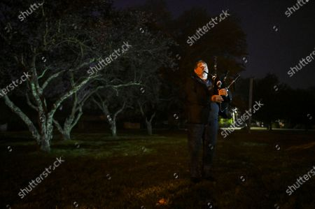 Christopher Nelson of the Braidwood RSL plays the bagpipes at dawn on AnzacDay in Braidwood, Australia, early 25 April 2019. Anzac Day is a national day of remembrance to commemorate the service and sacrifice of Australian and New Zealand service men and women. Due to restrictions aimed preventing the spread of the SARS-CoV-2 coronavirus which causes the COVID-19 disease, marches and commemorative services have been banned for the first time in more than a century.