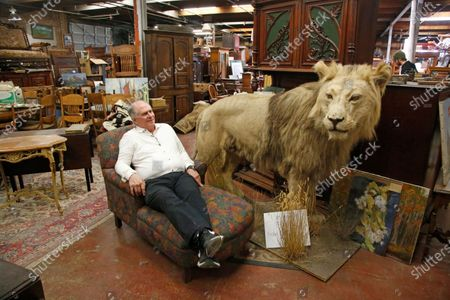 Euro Treasures Antiques owner Scott Evans sits in his store, in Salt Lake City. Evans is closing his art and antique store after 40 years. This year started out well for his business, then COVID-19 hit, along with shelter-in-place orders. With a drastic drop in customers, Evans says it was no longer cost effective to stay open