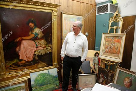 Euro Treasures Antiques owner Scott Evans walks in his store, in Salt Lake City. Evans is closing his art and antique store after 40 years. This year started out well for his business, then COVID-19 hit, along with shelter-in-place orders. With a drastic drop in customers, Evans says it was no longer cost effective to stay open