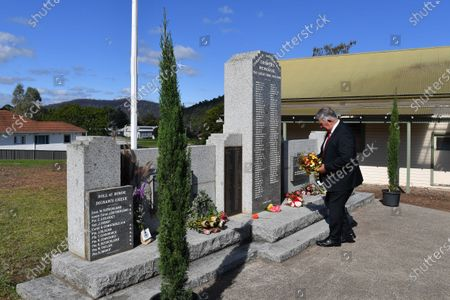 Councillor Tony Allen lays a wreath at the Cobargo Soldiers Memorial in Cobargo, one of the bushfire affected communities on the NSW South Coast, Australia, 25 April 2020. Anzac Day is a national day of remembrance to commemorate the service and sacrifice of Australian and New Zealand service men and women. Due to COVID-19 restrictions marches and commemorative services have been banned for the first time in more than a century.