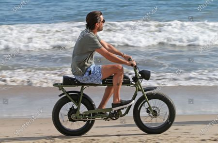 Scott Disick on his electric bike