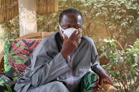 Amado Compaore sits outside his house days after his wife Rose Marie Compaore died from the new coronavirus, in Ouagadougou, Burkina Faso. Burkina Faso is one of Africa's nations hardest hit by the coronavirus with one of the highest number of fatalities in sub-Saharan Africa