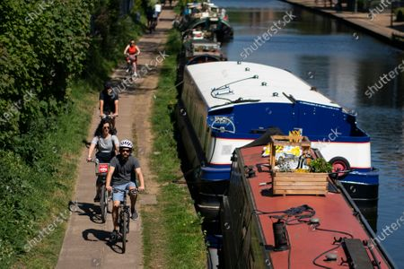 Members of the public use a tow path on a canal next to Victoria Park in London, Britain, 25 April, 2020. Britons are now in their fifth week of lockdown due to the Coronavirus pandemic. Countries around the world are taking increased measures to stem the widespread of the SARS-CoV-2 coronavirus which causes the Covid-19 disease.
